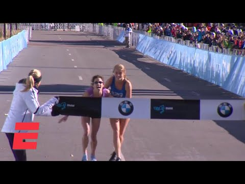Marathoner heroically finishes Dallas Marathon with help of fellow runner | ESPN