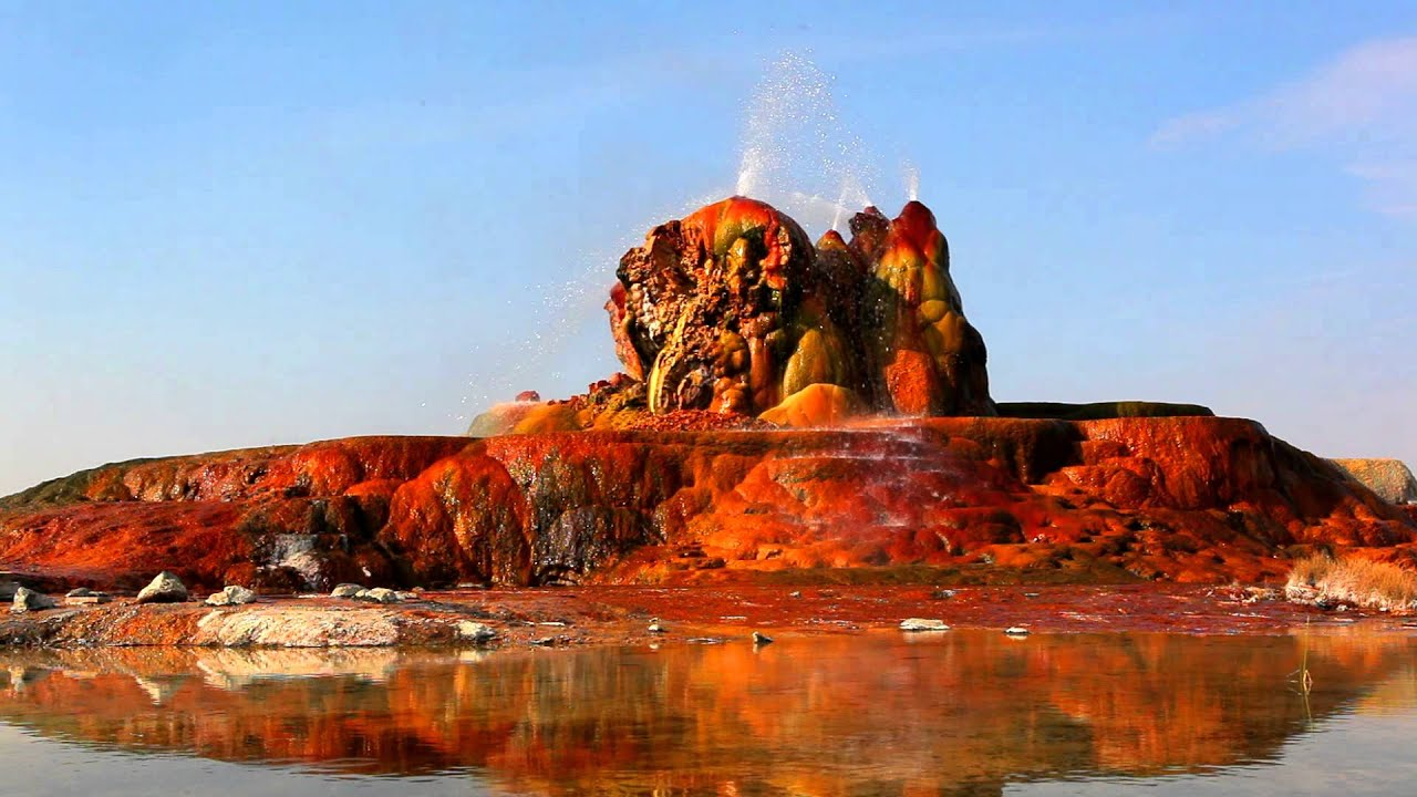 Black Desert Hd Wallpaper Water Shooting Out Of Fly Geyser And Splashing On The Red