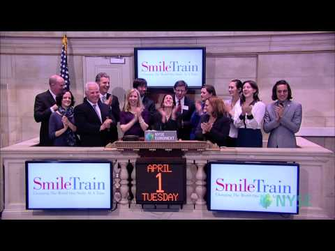 Westport resident Johanna Rossi helps Smile Train CEO Susannah Schaefer, staff and supporters ring the Closing Bell at the New York Stock Exchange on Tuesday.
