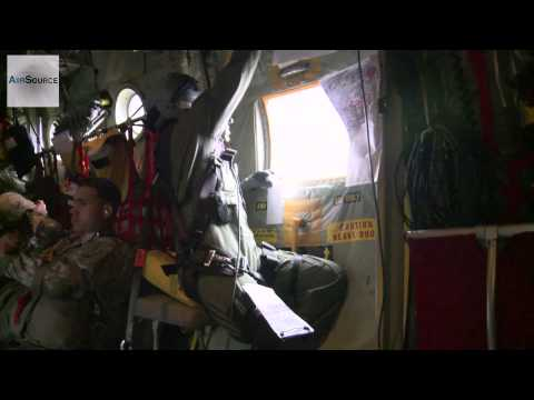 Royal Australian Air Force & Air National Guard C-130Js Drop Paratroopers