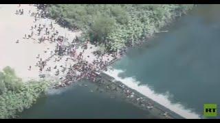 لقطات جديدة لآلاف المهاجرين يعبرون الحدود إلى الولايات المتحدة