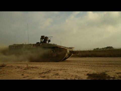 Israeli tanks patrol Gaza border during lull in fighting