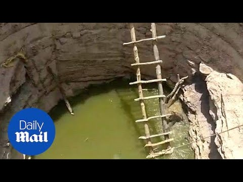 Dramatic moment a village rescues a leopard in a 20-foot well