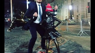 Suit-clad man is caught on camera humping newly installed 'Fearless Girl' statue