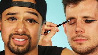 Repeat youtube video Guys Try Winged Eyeliner On Each Other