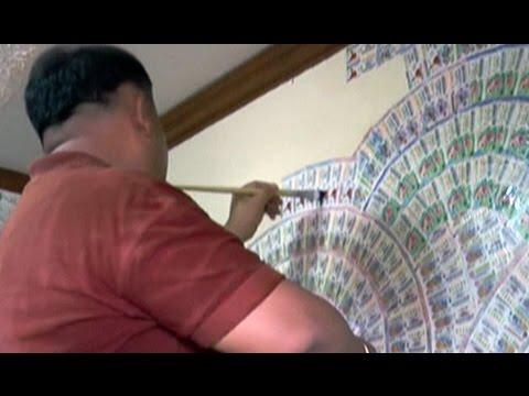 ThailandOnly 8/8/57 : ไอเดียเจ๋ง! นำลอตเตอรี่ทำวอลเปเปอร์บ้าน