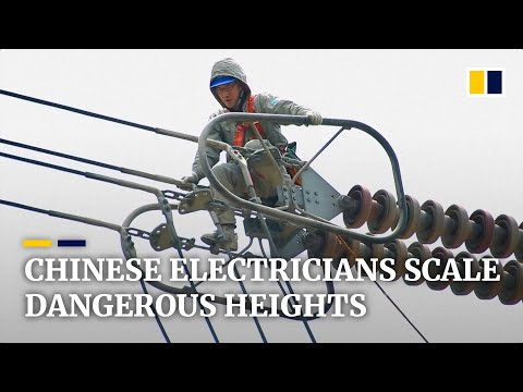 Chinese electricians scale dangerous heights to work on high-voltage lines