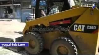 بالفيديو والصور.. رصف شارع الجامعة وإزالة القمامة من منطقة المسلة بالفيوم