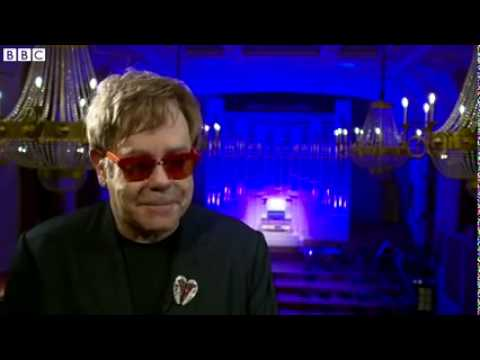 The philanthropy and musical history of Sir Elton John.
