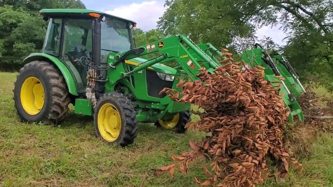 Greg is using tractor grapples to clear brush.