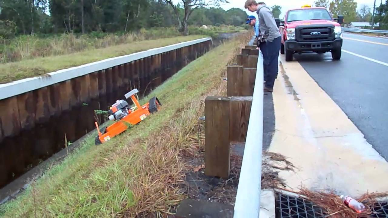 Extremely Steep Slope Mowing - YouTube