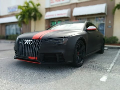 Audi RS 5 wrapped in 3M matte black with matte red stripes by Florida Car Wrap