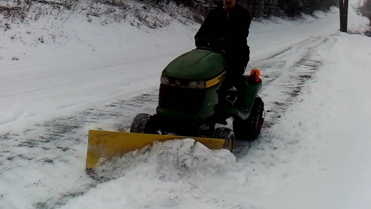 John Deere X300 Plowing Snow 2
