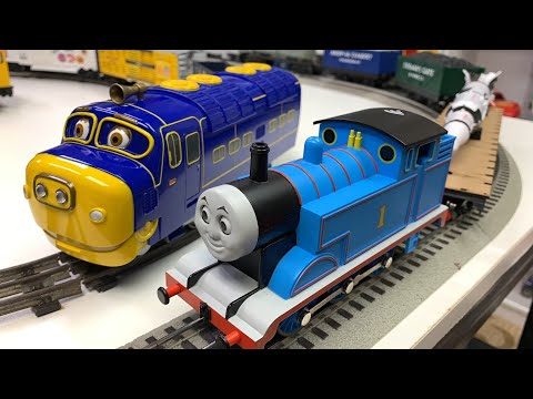 THOMAS, BREWSTER, LONG O SCALE TRAIN on Lionel Track with Saturn V Rocket and crashes