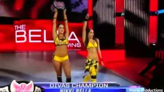 The Bella Twins enter the arena with John Cena