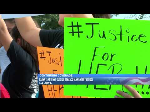 Parents protest outside Tabasco Elementary School