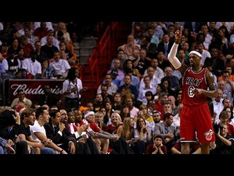 LeBron plays catch with Heat fan in stands!