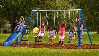 The kids play swing with friends at the park - Happy Kids without gadgets