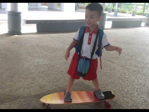 Calen Teo, 3 years old rides Globe Cruiser Longboard Skateboard to school
