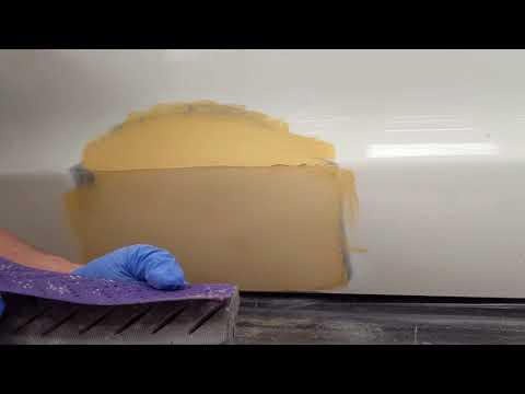 Car repair: close up putty sanding