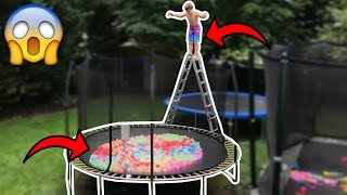 TRAMPOLINE FILLED WITH 10,000 WATER BALLOONS!