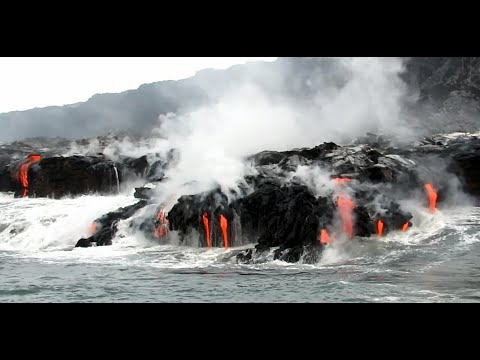 Lava meets the ocean, filmed from a boat on August 28, 2016. (The Big Island of Hawaii)