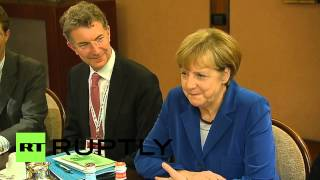 Italy: See Putin and Merkel talk Ukraine over breakfast at ASEM(Video ID: 20141017-020 M/S Russian President Vladimir Putin, German Chancellor Angela Merkel eating breakfast *NO SOUND AT SOURCE* M/S Russian ..., 2014-10-17T09:55:50.000Z)