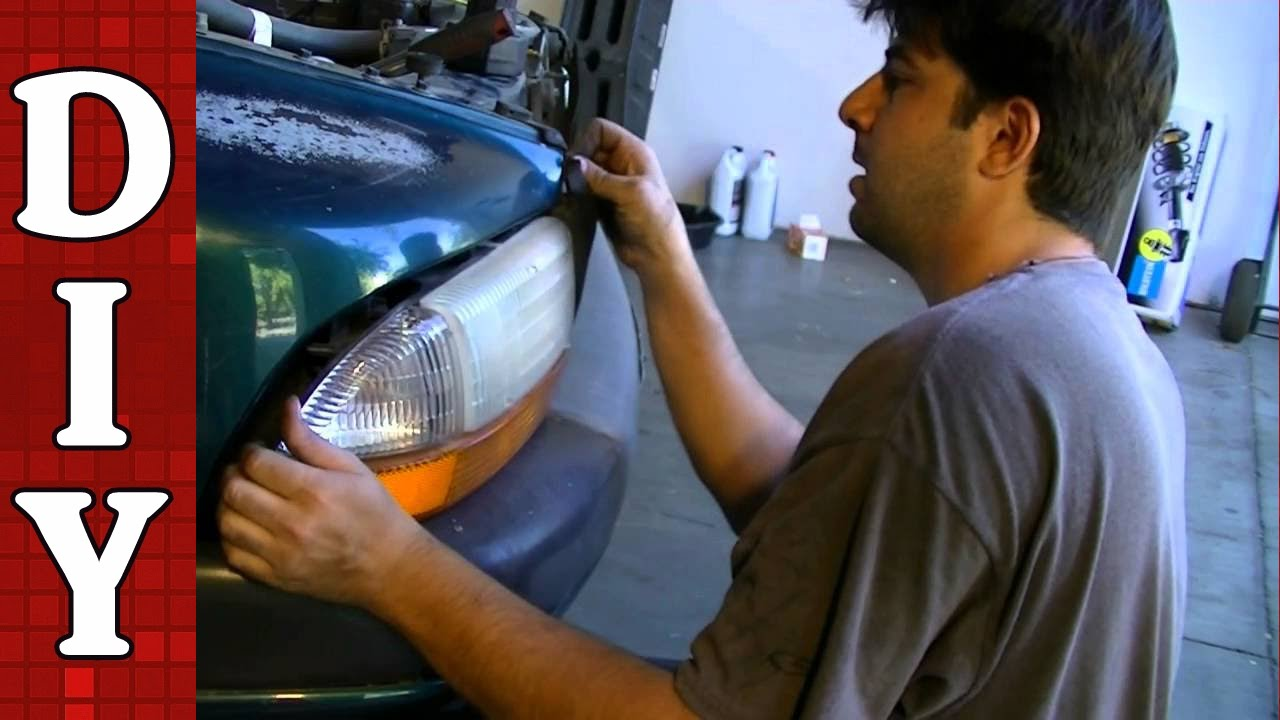 hight resolution of how to remove and replace a head light bulb and assembly dodge dakota sport youtube