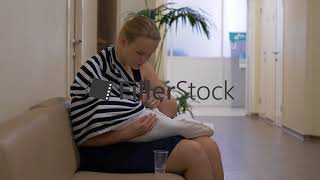 Woman nursing baby when waiting doctor in health center
