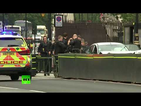 London Parliament incident: Police surround car & take suspect away