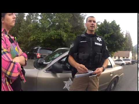 Police Sergeant Bruce Long seizes my license plate