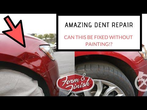 Charlotte's Paintless Dent Repair Expert Repairs An Audi A6 Fender Smash