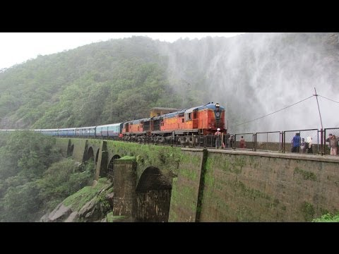 Indian Railways : Amaravati Express passing Dudhsagar waterfalls under drizzle