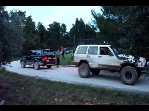 ssangyong musso vs Jeep Grand Cherokee - YouTube