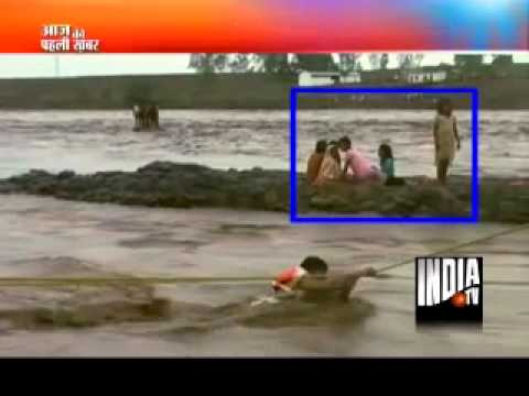 2 brave men rescued 23 people throug heavy flood in Narmada river !