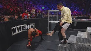 Jerry Lawler sends Michael Cole crashing into the