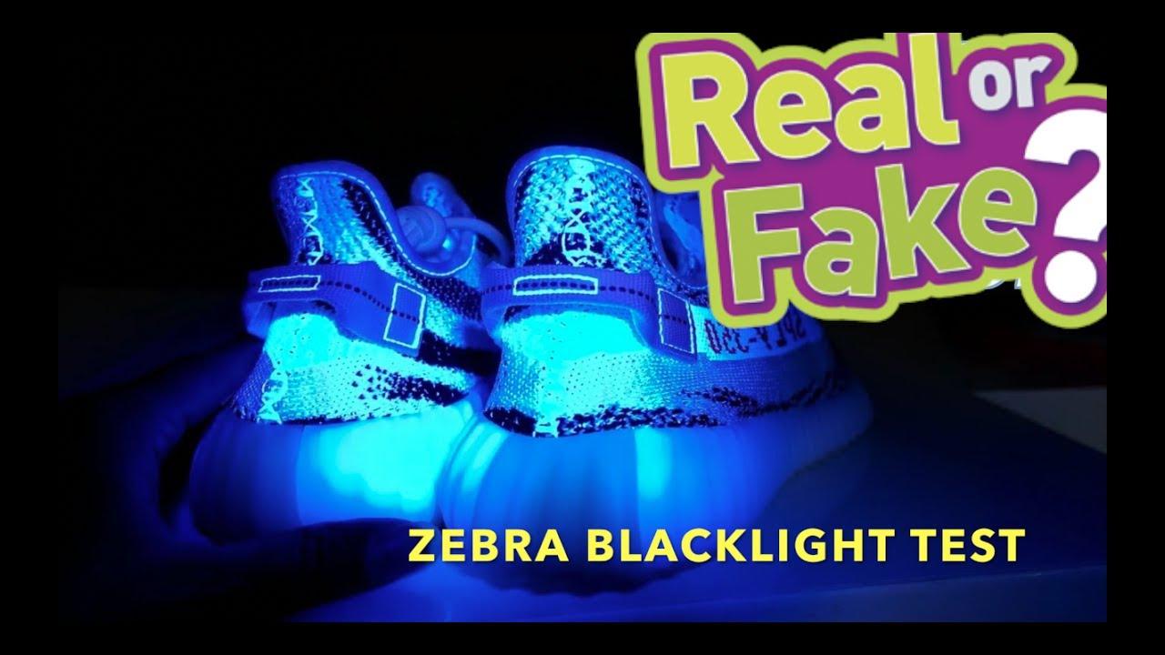 4e157130419ed YEEZY BOOST 350 V2 ZEBRA Real Vs. Fake BLACKLIGHT TEST - YouTube