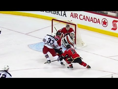 Byfuglien shows off quick hands by finding just enough room to score