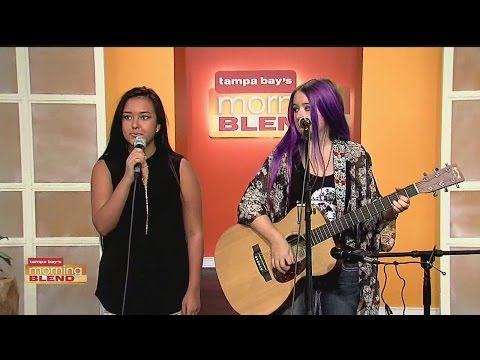 Sierra and Leslie perform an original song