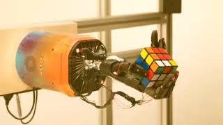 OpenAI robot hand solves a Rubik's cube