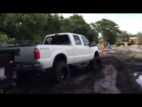 Lifted 6.7 Powerstroke pulling trailer through mud - YouTube