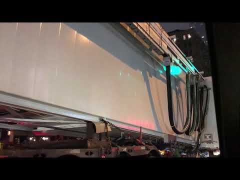 "A ""ONLY IN NEW YORK"" VIDEO OF A AIRPORT JETWAY BEING TRANSPORTED THROUGH THE STREET OF NYC."
