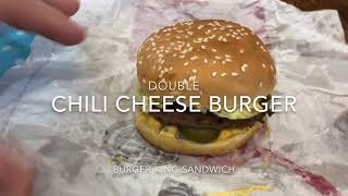 Double chili cheese burger with extras Burger King Sandwich hands on