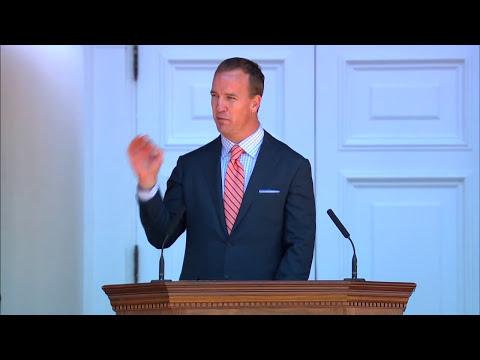 Peyton Manning Passes Footballs and Advice to Graduating Students