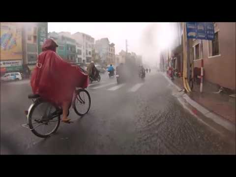 Scooter ride during the monsoon in Ho Chi Minh City, Vietnam