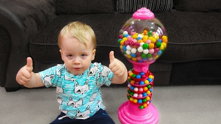 Funny Alex playing with Giant Gumball mashine