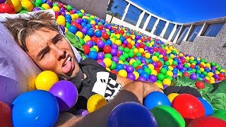 24 HOUR CHALLENGE IN OUR ROOFTOP BALL PIT! (100,000 BALLS)
