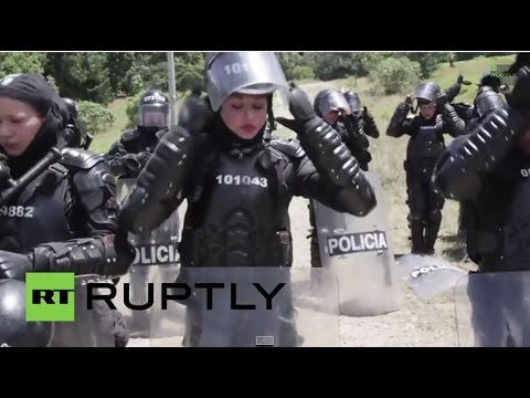 Colombia: All-female police brigade battle it out in mock-riot