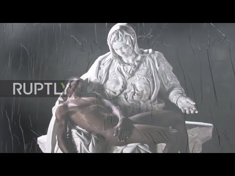 Italy: Virgin Mary cradling black refugee 'Jesus' stuns Milan