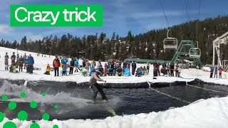 Snowboarder clears 60ft pond before somersaulting at California ski resort
